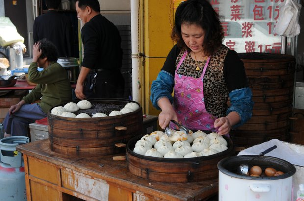 A lady attending to her Dim Sum on an early Sunday afternoon.