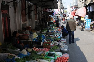 Local merchants line the streets with their products.