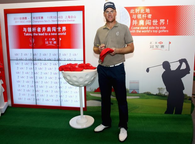 Robert Karlsson attends an autograph-signing session after the first round of the WGC-HSBC Champions.