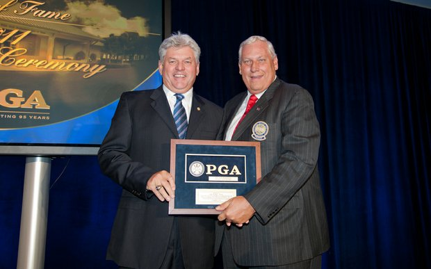Hall of Fame inductee Jim Remy and PGA president Allen Wronowski at the Hall of Fame ceremony