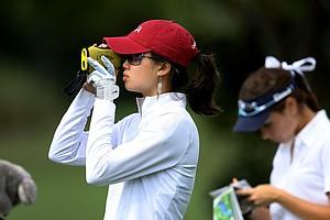 Rachel Dai checks out the yardage at the par-3, No. 17 during the Golfweek East Coast Junior Invitational at Shingle Creek Golf Club.