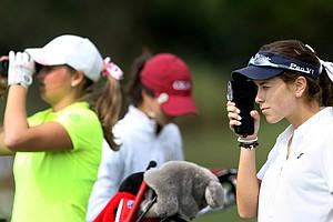 Samantha Marks takes the yardage of the par-3, No. 17 during the Golfweek East Coast Junior Invitational at Shingle Creek Golf Club.