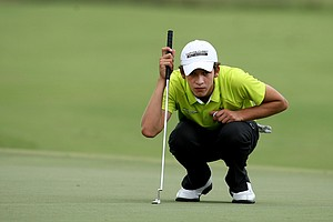 Johan Werge lines up a putt during the Golfweek East Coast Junior Invitational at Shingle Creek Golf Club.