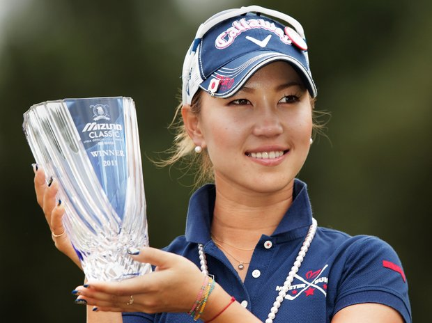 Momoko Ueda of Japan celebrates her victory with the trophy after the 3rd playoff hole in the final round of the Mizuno Classic.