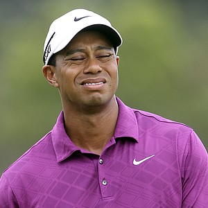 Tiger Woods reacts to a put on the third green during the first round of the Australian Open