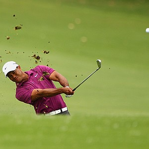 Tiger Woods hits his second shot on the second hole at the 2011 Australian Open.