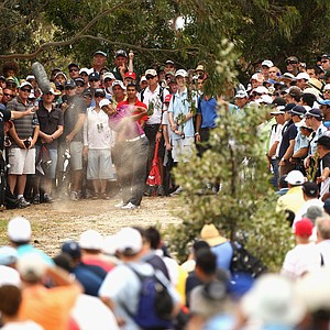 Tiger Woods hits out of the rough on the third hole at the 2011 Australian Open.