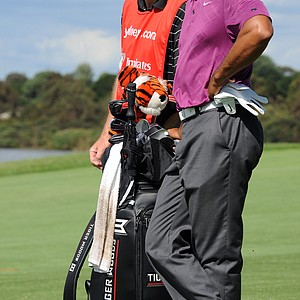Tiger Woods and his caddie Joe La Cava wait their turn on the fairway of the 11th hole during the first round of the 2011 Australian Open.