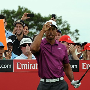 Tiger Woods acknowledges the applause before teeing off for his first shot in the 2011 Australian Open.