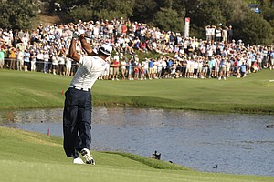 Tiger Woods plays a shot on the 11th fairway during the second round of the Australian Open.