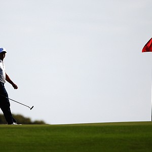 Tiger Woods walks on the 12th green during day two of the 2011 Australian Open.