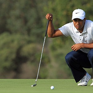 Tiger Woods putts on the 12th hole during day two of the 2011 Australian Open.