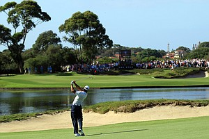 Tiger Woods hits his second shot on the 14th hole during day two of the 2011 Australian Open.