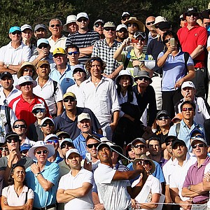 Tiger Woods hits his third shot on the 11th hole during day two of the 2011 Australian Open.