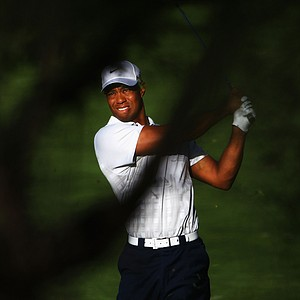 Tiger Woods hits his second shot on the 10th Hole during day two of the 2011 Australian Open.
