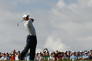 Tiger Woods plays his second shot on the 11th hole during day two of the 2011 Australian Open.