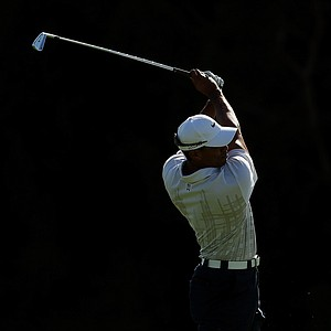 Tiger Woods plays his second shot on the 14th hole during day two of the 2011 Australian Open.