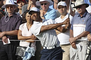 Tiger Woods chips onto the 11th green during the second round of the Australian Open.