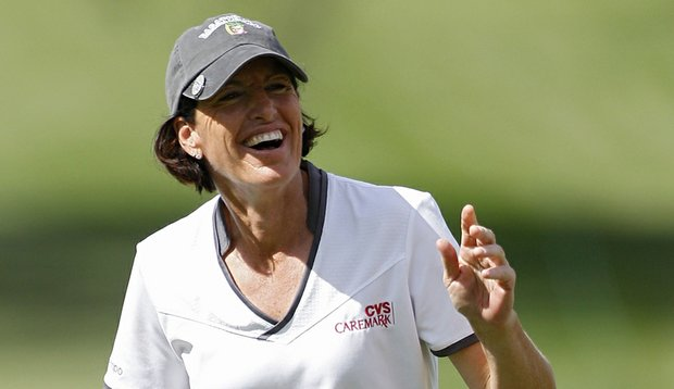 Juli Inkster of the United States reacts after chipping in for a birdie on the ninth green during the first round of the Lorena Ochoa Invitational.
