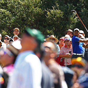 Tiger Woods tees off on the eighth hole during day three of the 2011 Australian Open.