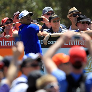 Tiger Woods follows his tee shot on the third hole during day three of the 2011 Australian Open.