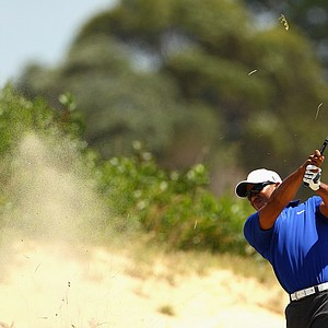 Tiger Woods hits his second shot on the third hole during day three of the 2011 Australian Open.