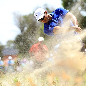 Tiger Woods hits his second shot from the waste sand on the third hole during day three of the 2011 Australian Open.