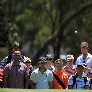 Tiger Woods plays his third shot on the second hole during day three of the 2011 Australian Open.