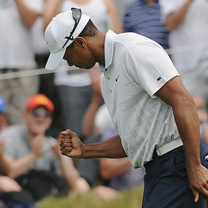 Tiger Woods reacts after sinking a long putt during Round 2 of the Australian Open.