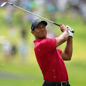 Tiger Woods hits his second shot on the first hole during day four of the 2011 Australian Open.