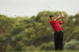 Tiger Woods plays his second shot on the third hole during day four of the 2011 Australian Open.
