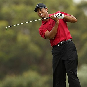 Tiger Woods watches his second shot on the third hole during day four of the 2011 Australian Open.