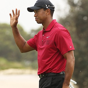 Tiger Woods acknowledges the crowd after holing a putt for birdie on the third hole during day four of the 2011 Australian Open.