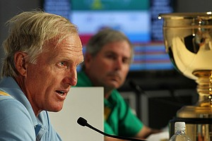 International captain Greg Norman, left, with U.S. captain Fred Couples at a Presidents Cup press conference.