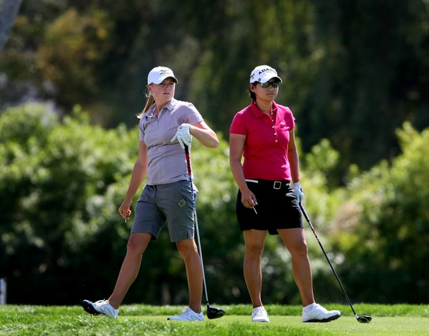 Stacy Lewis, left, and Yani Tseng, right, during the final round of the Kraft Nabisco Championship.