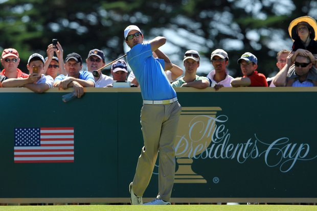Adam Scott, of the International squad, tees off at Royal Melbourne.