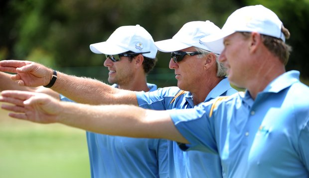 International team captain Greg Norman (center) talks with teammates Ernie Els of South Africa (right) and Adam Scott of Australia (left) during a practice round for the President's Cup.