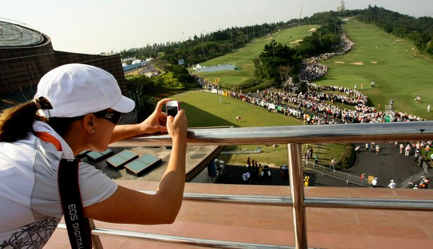 LPGA player Sophie Gustafson climbed to the rooftop of Sunrise Golf and Country Club to get pictures of the Yani Tseng madness during Saturday's round of the inaugural 2011 Sunrise LPGA Taiwan Championship.