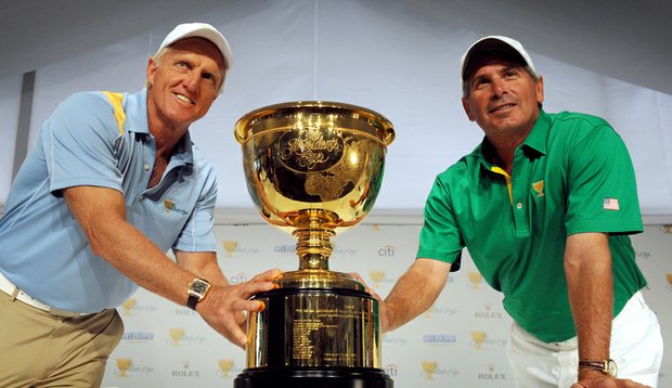 International captain Greg Norman and American captain Fred Couples flank the Presidents Cup.