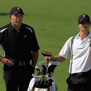 Adam Scott with caddie Steve Williams.