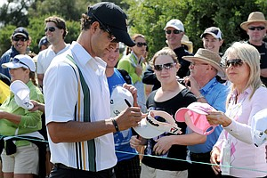 Adam Scott signs autographs for the crowd at Royal Melbourne.