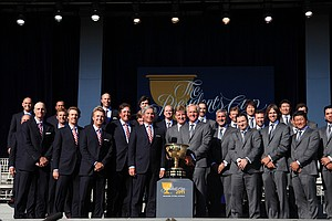 The American team (left) and the International team (right) before the start of the Presidents Cup.