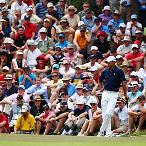 Tiger Woods of the U.S. waits on the fourth green as a gallery of fans watch play during the Day 1 Foursome matches at the 2011 Presidents Cup.