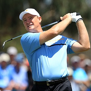 Ernie Els of the International team hits his second shot on the first hole during the Day 1 Foursome matches at the 2011 Presidents Cup.