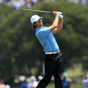 Aaron Baddeley of the International team hits his second shot on the first hole during the Day 1 Foursome matches at the 2011 Presidents Cup.