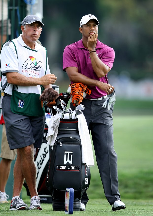 Tiger Woods and his former caddie Steve Williams at No. 18 during Round 3 of the Arnold Palmer Invitational at Bay Hill Club & Lodge. Woods let his longtime caddie go in July.