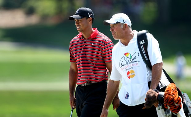 Tiger Woods and his former caddie Steve Williams at No. 17 during the final round of the Arnold Palmer Invitational at Bay Hill Club & Lodge. Woods let his caddie go in July.