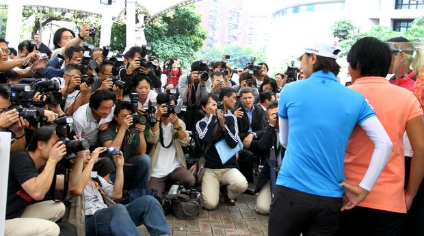A mass of media crowds around Na Yeon Choi, Yani Tseng and Suzann Pettersen during a LPGA press conference near Taipei 101 in downtown Taipei.
