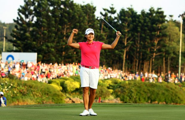 Yani Tseng raises her arms in victory after winning during the inaugural 2011 Sunrise LPGA Taiwan Championship in her home country by 5-strokes.