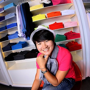 "Yani Tseng photographed riding the escalator proclaiming she's ""No. 1"" at The Mall at Millenia early in the year."